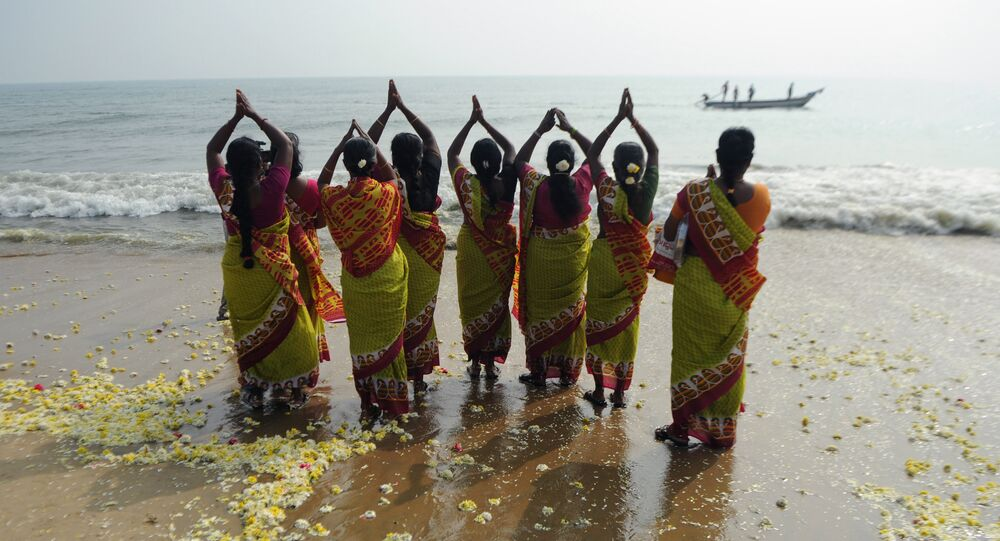 Indian women offer prayers at Marina Beach in Chennai