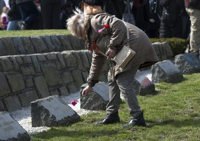 A woman lays a flower put flowers at the WWII memorial for Soviet soldiers, called the Slavin in Bratislava. (File)