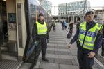Swedish police prepare to check an incoming train at the Swedish end of the bridge between Sweden and Denmark in Malmo, Sweden