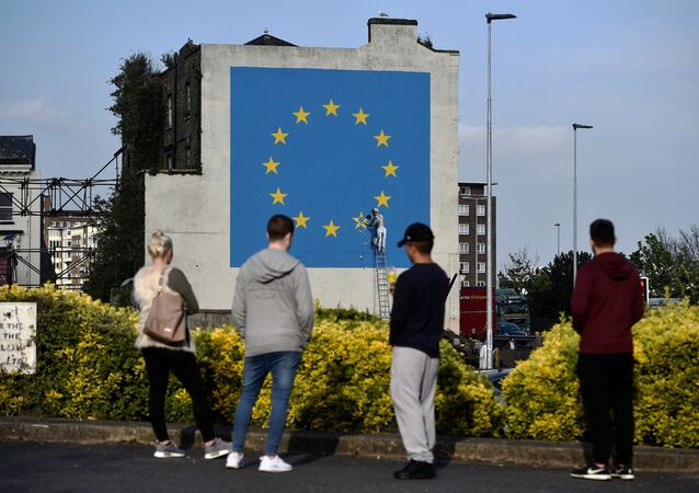 An artwork attributed to street artist Banksy, depicting a workman chipping away at one of the 12 stars on the flag of the European Union, is seen on a wall in the ferry port of Dover, Britain May 7, 2017.