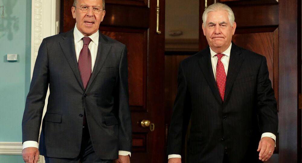 U.S. Secretary of State Rex Tillerson (R) walks with Russian Foreign Minister Sergey Lavrov before their meeting at the State Department in Washington, U.S