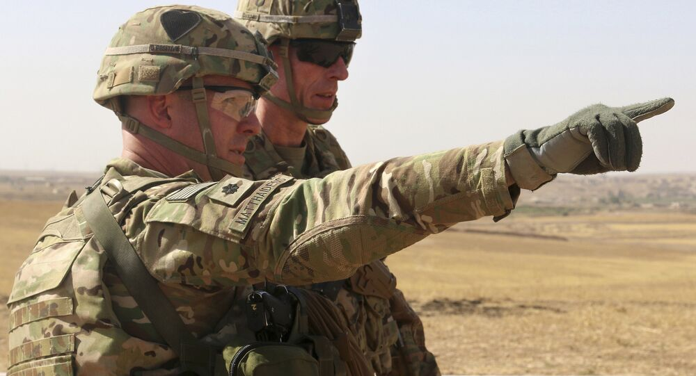 U.S. Army Lt. Col. Ed Matthaidess, commander, left, Task Force Falcon, outlining areas of an Iraqi security forces tactical assembly area to U.S. Army Maj. Gen. Gary J. Volesky, commander, Combined Joint Forces Land Component Command – Operation Inherent Resolve, in northern Iraq, prior to the start of the Mosul offensive. (File)