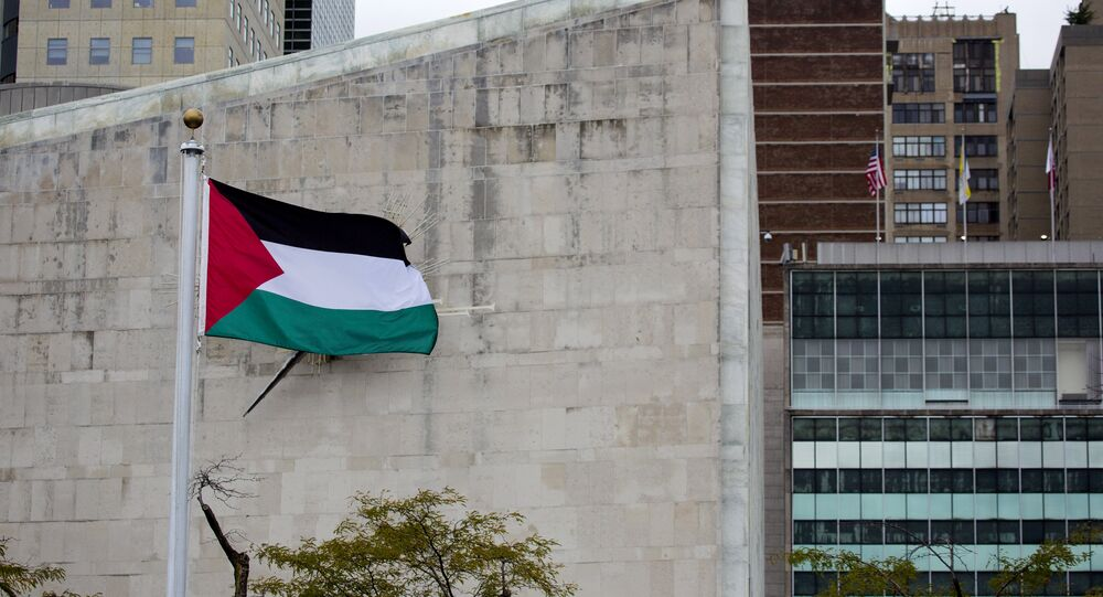 The Palestinian flag flies in the wind after a Rose Garden ceremony at the United Nations headquarters