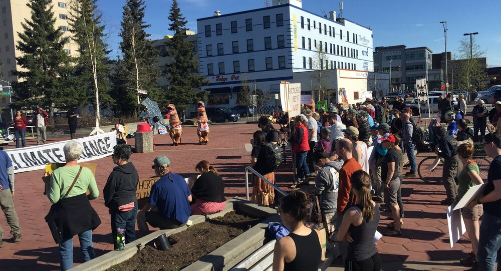 Some 200 people gathered in downtown of Fairbanks, Alaska on Wednesday evening to protest against climate change on the eve of the Arctic Council Ministerial, scheduled for May 11