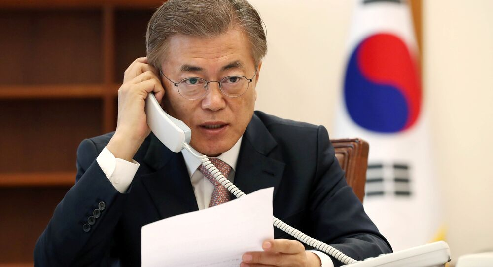 South Korean President Moon Jae-in speaks with Chinese President Xi Jinping by telephone at the Presidential Blue House in Seoul, South Korea in this handout picture provided by the Presidential Blue House and released by Yonhap on May 11, 2017
