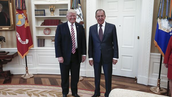 A handout photo made available by the Russian Foreign Ministry on May 10, 2017 shows US President Donald J. Trump (L) posing with Russian Foreign Minister Sergei Lavrov during a meeting at the White House in Washington, DC. - Sputnik International