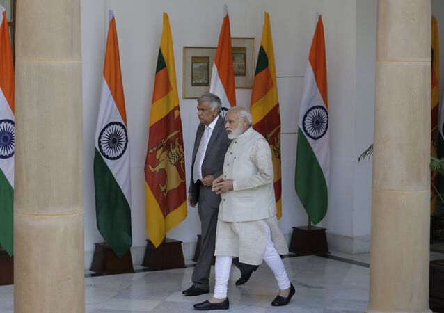 Indian Prime Minister Narendra Modi, right, talks with his Sri Lankan counterpart Ranil Wickremesinghe as they walk for their meeting in New Delhi, India, Wednesday, April 26, 2017