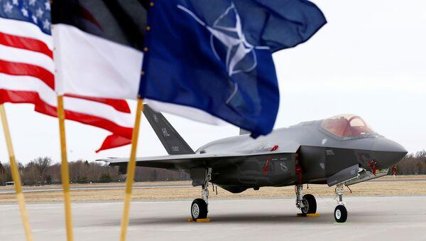 U.S., Estonia's and NATO flags flutter next to the U.S. Air Force F-35A Lightning II fighter in Amari air base, Estonia, April 25, 2017 - Sputnik International