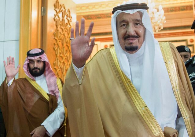 In this photo released by the Saudi Press Agency, SPA, Saudi King Salman, right, and Defense Minister and Deputy Crown Prince Mohammed bin Salman wave as they leave the hall after talks with the British prime minister, in Riyadh, Saudi Arabia, Wednesday, April 5, 2017.