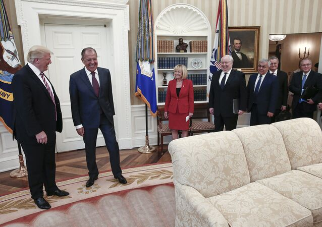 US President Donald J. Trump (L) and Russian Foreign Minister Sergei Lavrov (2-L) during a meeting at the White House in Washington, DC