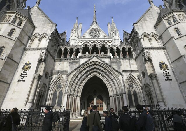 In this Thursday Nov. 3, 2016 file photo media gather outside the High Court in London
