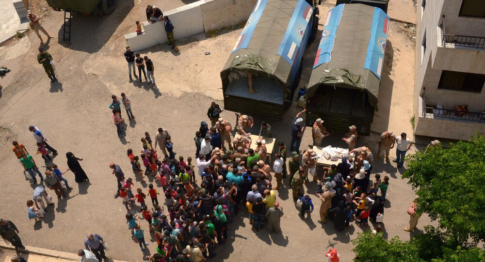 Russian humanitarian aid is distributed at Ras al-Bassit refugee camp