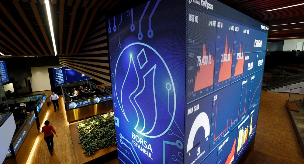 Traders walk on the floor of the Borsa Istanbul in Istanbul, Turkey, February 29, 2016