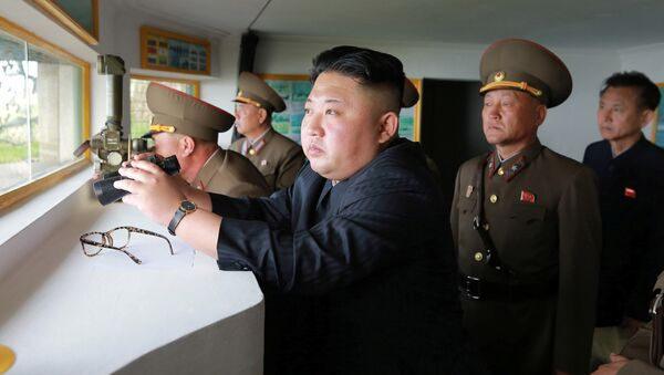 North Korean leader Kim Jong Un inspects the defence detachment on Jangjae Islet and the Hero Defence Detachment on Mu Islet located in the southernmost part of the waters off the southwest front, in this undated photo released by North Korea's Korean Central News Agency (KCNA) on May 5, 2017 - Sputnik International