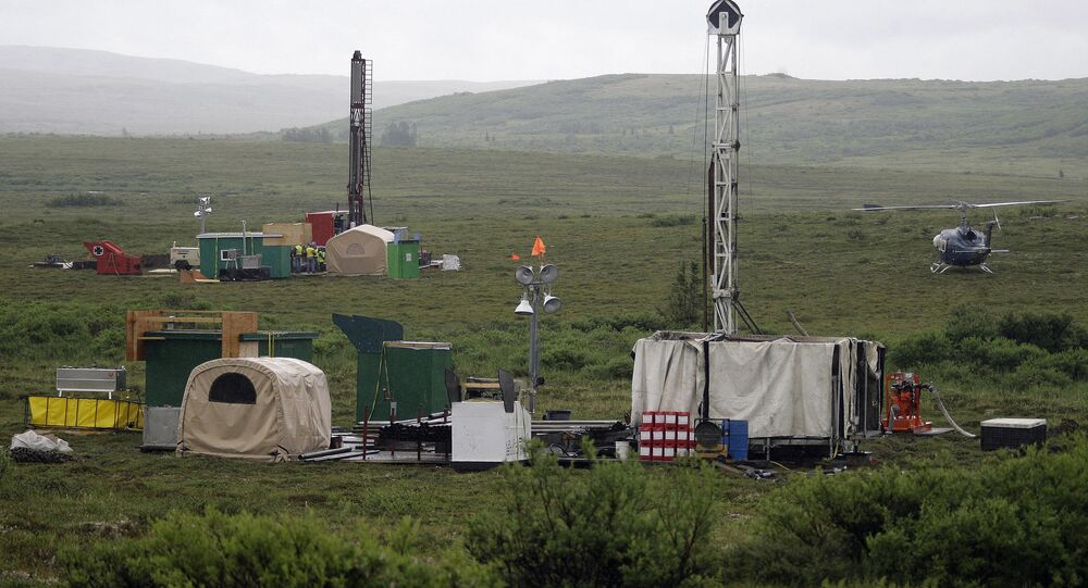 In this July 13, 2007 file photo, workers with the Pebble Mine project test drill in the Bristol Bay region of Alaska near the village of Iliamma