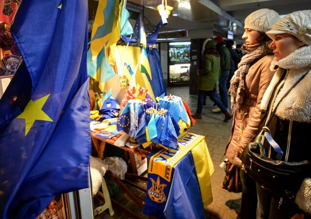 Girls look on at souvenirs in the underpass on Independence Square, Kiev. File photo