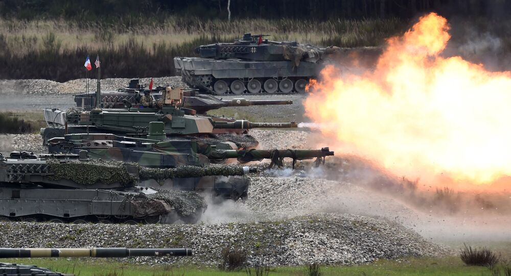 Tanks of several nations shoot at the same time during the friendship shooting of the exercise 'Strong Europe Tank Challenge 2017' at the exercise area in Grafenwoehr, near Eschenbach, southern Germany, on May 12, 2017
