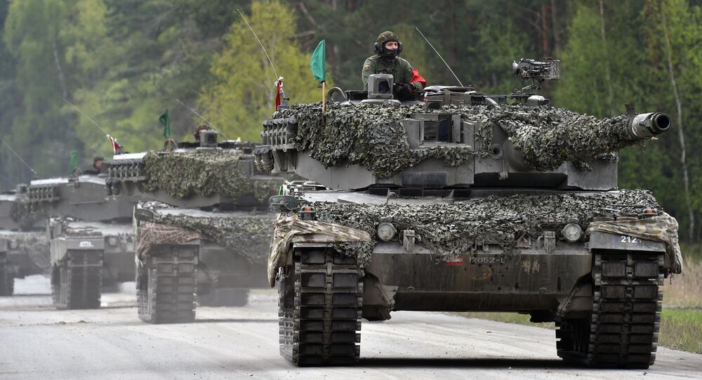 An Austrian soldier arrives with a tank type 'Leopard' prior the friendship shooting of several nations during the exercise 'Strong Europe Tank Challenge 2017' at the exercise area in Grafenwoehr, near Eschenbach, southern Germany, on May 12, 2017
