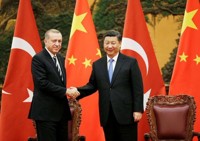 Turkish President Recep Tayyip Erdogan and Chinese President Xi Jinping attend a signing ceremony ahead of the Belt and Road Forum in Beijing, China May 13, 2017