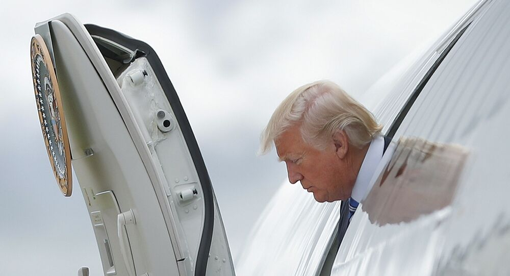 President Donald Trump steps out of Air Force One
