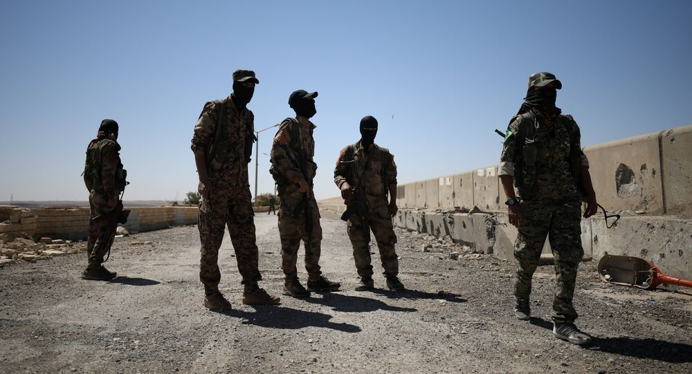 Syrian Democratic Forces (SDF) fighters stand in the town of Tabqa, after capturing it from Islamic State militants this week, Syria May 12, 2017
