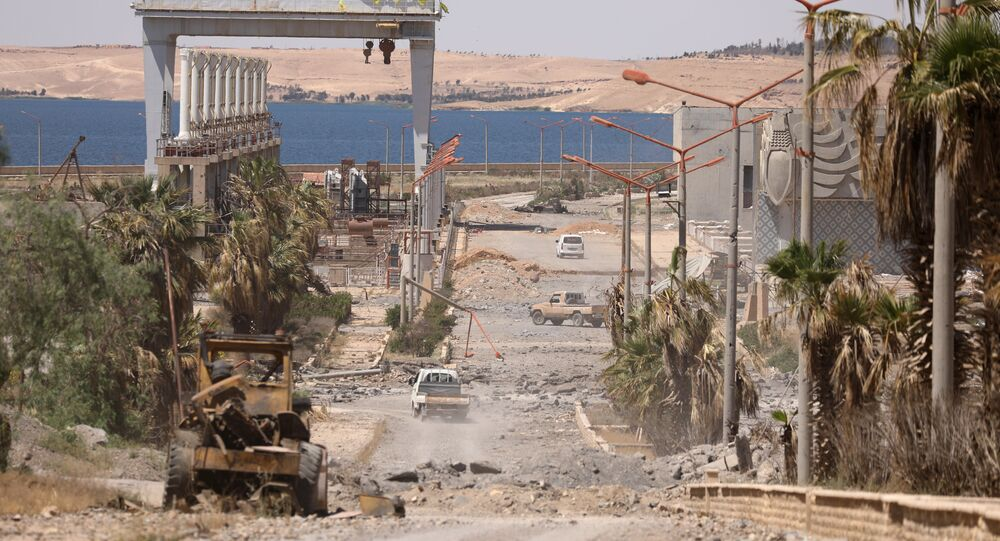 Vehicles drive near Tabqa Dam on the Euphrates River, in the town of Tabqa, after Syrian Democratic Forces (SDF) captured it from Islamic State militants this week, Syria May 12, 2017. Picture taken May 12, 2017