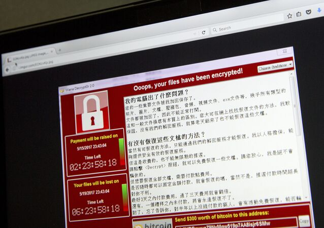 A screenshot of the warning screen from a purported ransomware attack, as captured by a computer user in Taiwan, is seen on laptop in Beijing, Saturday, May 13, 2017