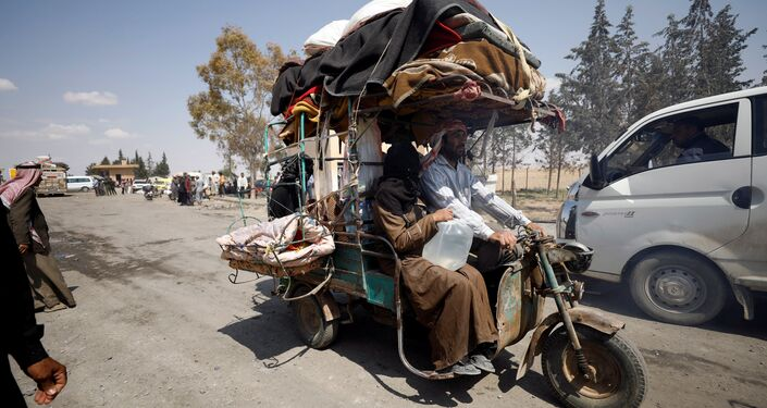 Internally displaced people who fled Raqqa city ride a tricycle with their belongings as they leave a camp in Ain Issa, Raqqa Governorate, Syria May 4, 2017