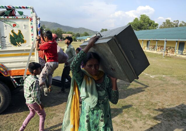 Indians evacuated from their village following cross-border shelling, arrive at a relief camp set up at a government school at Nowshera sector, along the highly militarized Line of Control that divides the region between India and Pakistan, Saturday, May 13, 2017