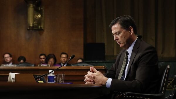 In this Wednesday, May 3, 2017, photo then-FBI Director James Comey pauses as he testifies on Capitol Hill in Washington, before a Senate Judiciary Committee hearing - Sputnik International