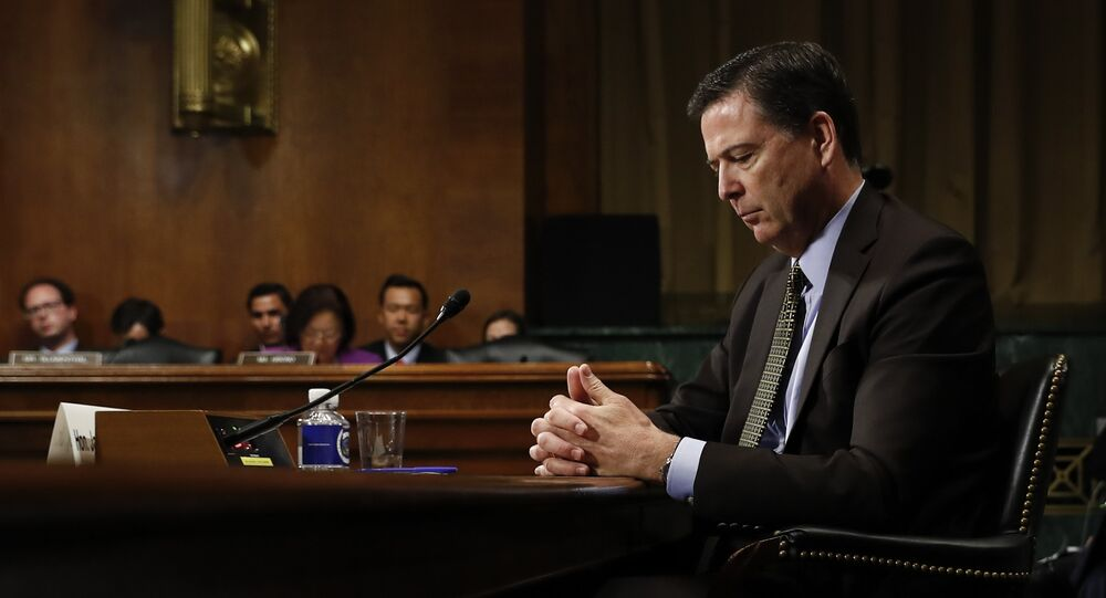 Then-FBI Director James Comey pauses as he testifies on Capitol Hill in Washington, before a Senate Judiciary Committee hearing