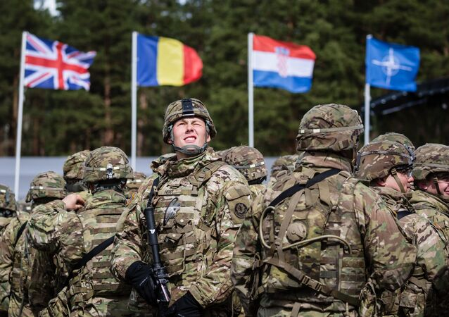 US soldiers are pictured prior the beginning of the official welcoming ceremony of NATO troops in Orzysz, Poland, on April 13, 2017.