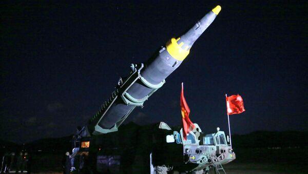 North Korean leader Kim Jong Un inspects the long-range strategic ballistic rocket Hwasong-12 (Mars-12) in this undated photo released by North Korea's Korean Central News Agency (KCNA) on May 15, 2017. - Sputnik International