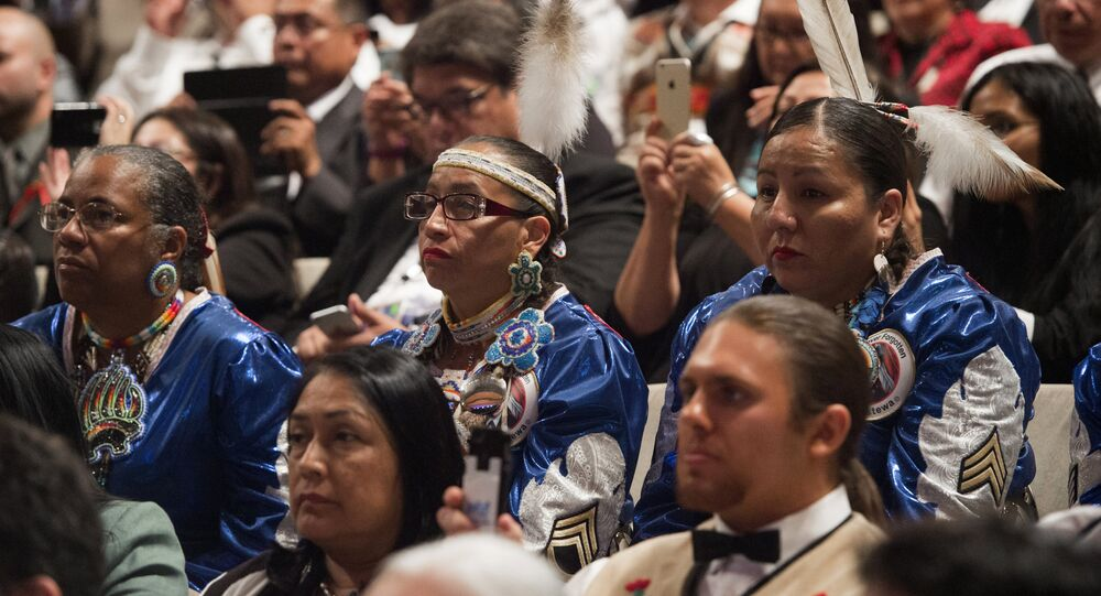 People listen as US President Barack Obama speaks during a panel discussion during the 2015 White House Tribal Nations Conference at the Ronald Reagan Building and International Trade Center in Washington, DC, November 5, 2015.