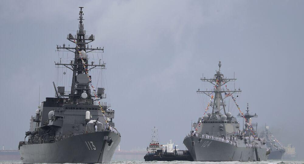 Japan's destroyer JS Sazanami, left, the United State's Arleigh Burke-class guided missile destroyer USS Sterett, center, and South Korean destroyer ROKS Dae Jo Yeong, right rear.