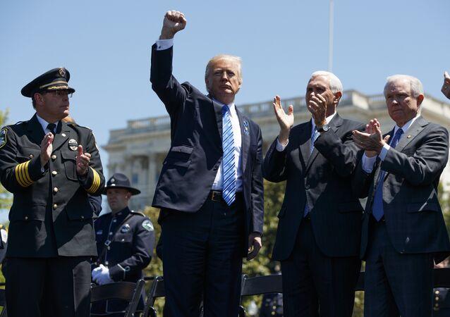 President Donald Trump pumps his fist.