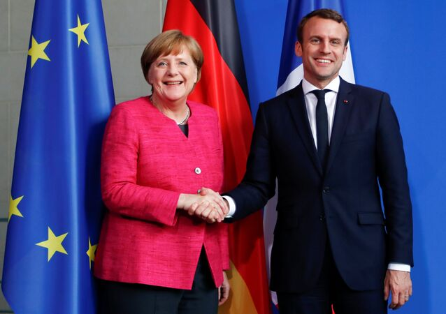 German Chancellor Angela Merkel and French President Emmanuel Macron shake hands after a news conference at the Chancellery in Berlin, Germany, May 15, 2017.