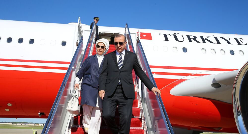 Turkish President Tayyip Erdogan, accompanied by his wife Emine Erdogan, disembarks from a plane upon his arrival in Washington, US May 15, 2017.