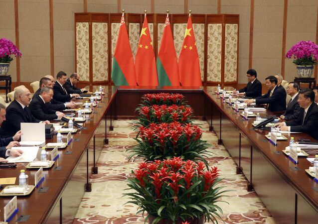 Belarus President Alexander Lukashenko, left, and Chinese President Xi Jinping, right, attend a bilateral meeting at Diaoyutai State Guesthouse in Beijing, Tuesday, May 16, 2017.