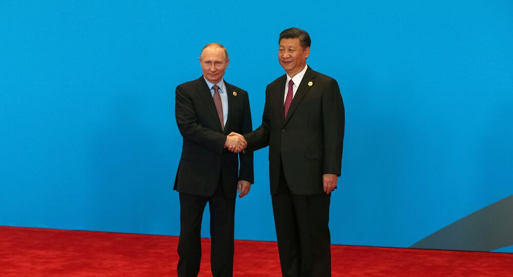 Chinese President Xi Jinping shake hands with Russian President Vladimir Putin as they attend the welcome ceremony at Yanqi Lake during the Belt and Road Forum, in Beijing, China, May 15, 2017.