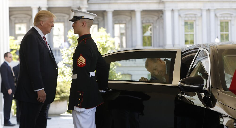 President Donald Trump watches Turkish President Recep Tayyip Erdogan get into his vehicle