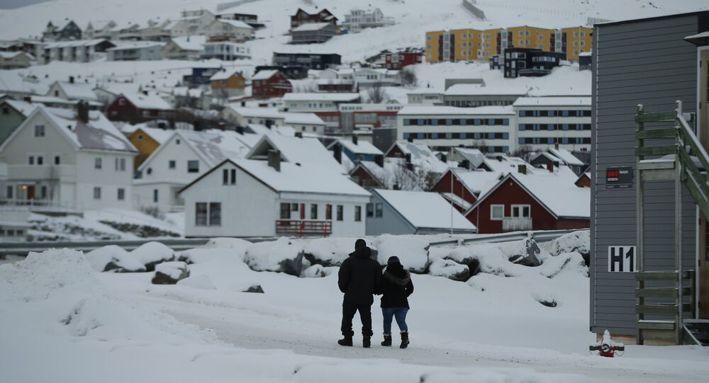 In this photo taken Thursday, Feb. 4, 2016, asylum seekers leave the refugee camp in Hammerfest, to walk to the town's centre, in northern Norway.