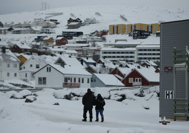 In this photo taken Thursday, Feb. 4, 2016, asylum seekers leave the refugee camp in Hammerfest, to walk to the town's centre, in northern Norway. (photo used for illustration purpose only)