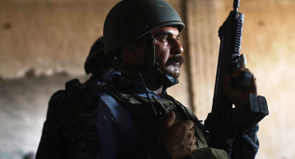 A member of Iraqi Federal Police stands guard at a factory used by Islamic State militants to manufacture home made mortars in western Mosul, Iraq, May 11, 2017.