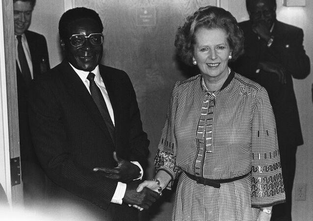 Prime Minister Margaret Thatcher of Great Britain meets with President Robert Mugabe of Zimbabwe in Nassau, Friday, Oct. 18, 1985 before the morning session of the Commonwealth Heads of Government Meeting.