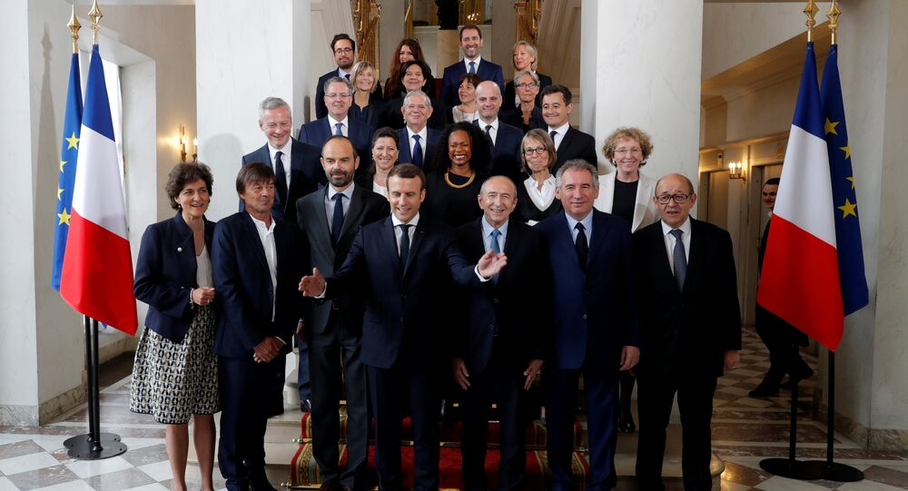 French President Emmanuel Macron (4thL) and Prime Minister Edouard Philippe (3rdL) pose for a family photo after the first cabinet meeting at the Elysee Palace in Paris, France, May 18, 2017.