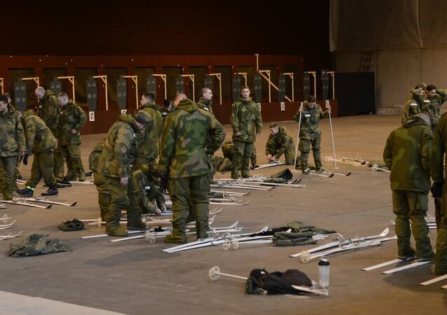 Soldiers and Airmen with the Minnesota National Guard begin the process of adjusting the binding mechanics on their Nordic skis at Camp Vaernes, Norway, on Feb. 11, 2017.