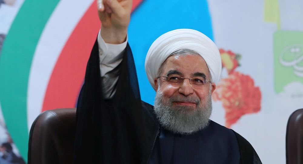 Iran's President Hassan Rouhani gestures as he registers to run for a second four-year term in the May election, in Tehran, Iran, April 14, 2017.