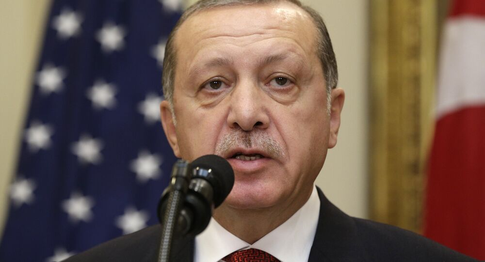 Turkey's President Recep Tayyip Erdogan delivers a statement to reporters alongside US President Donald Trump after their meeting at the White House in Washington
