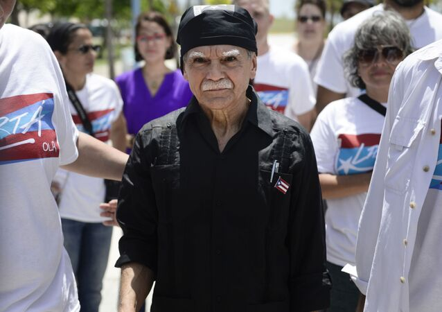 Puerto Rican nationalist Oscar Lopez Rivera arrives to give a press conference on El Escambron Beach following his release from house arrest after decades in custody, in San Juan, Puerto Rico, Wednesday, May 17, 2017.